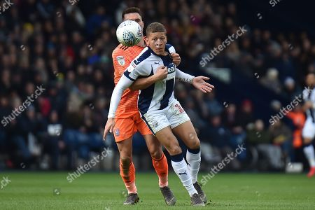 Ipswich Town defender Jonas Knudsen (3) holds West Bromwich Albion striker (on loan from Newcastle United) Dwight Gayle (16) during the EFL Sky Bet Championship match between West Bromwich Albion and Ipswich Town at The Hawthorns, West Bromwich