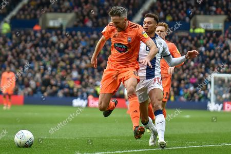 Ipswich Town midfielder Cole Skuse (8) keeps West Bromwich Albion midfielder (on loan from Newcastle United) Jacob Murphy (70) in check during the EFL Sky Bet Championship match between West Bromwich Albion and Ipswich Town at The Hawthorns, West Bromwich