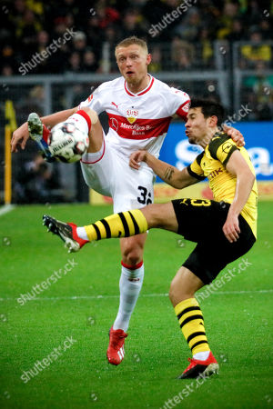Stuttgart's Andreas Beck (L) in action against Dortmund's Raphael Guerreiro (R) during the German Bundesliga soccer match between Borussia Dortmund and VfB Stuttgart in Dortmund, Germany, 09 March 2019.