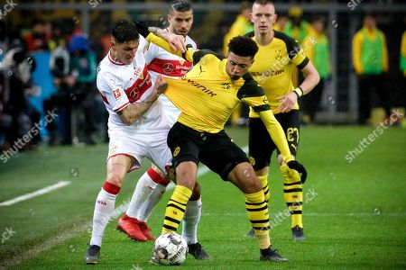 Stuttgart's Steven Zuber (L) in action against Dortmund's Jadon Sancho (R) during the German Bundesliga soccer match between Borussia Dortmund and VfB Stuttgart in Dortmund, Germany, 09 March 2019.
