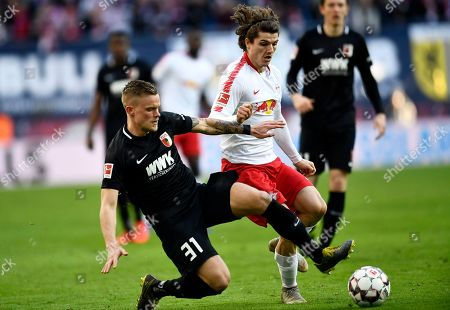 Leipzig's Marcel Sabitzer (R) and Augsburg's Philipp Max in action during the German Bundesliga soccer match between RB Leipzig and FC Augsburg, in Leipzig, Germany, 09 March 2019.