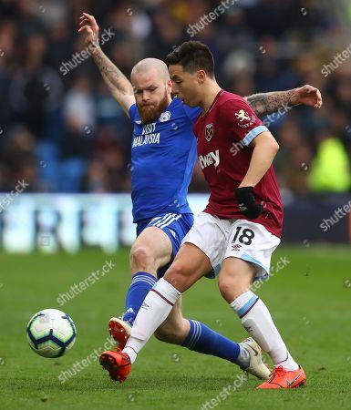 Aron Gunnarsson of Cardiff City tackles Samir Nasri of West Ham United