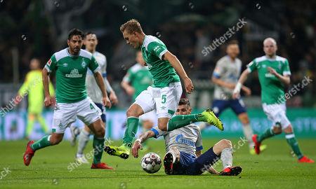 08.03.2019, Football 1. Bundesliga 2018/2019, 25.  match day, Werder Bremen - FC Schalke 04, Weserstadium Bremen. (L-R) Ludwig Augustinsson (Werder Bremen)  -  Daniel Caligiuri (Schalke)