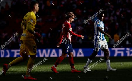 Atletico de Madrid's forward Antoine Griezmann (C) and Leganes' goalkeeper Andriy Lunin (L) and forward Kenneth Omeruo (R) during the Spanish LaLiga soccer match between Atletico de Madrid and CD Leganes at Wanda Metropolitano stadium in Madrid, Spain, 09 March 2019.