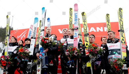 1st placed Team Norway (C) with Robert Johansson, Johann Andre Forfang, Robin Pedersen and Marius Lindvik, flanked by 2nd placed Team Japan (L) with Yukiya Sato, Noriaki Kasai, Junshiro Kobayashi and Ryoyu Kobayashi, and 3rd placed Austria (R) with Michael Hayboeck, Manuel Fettner, Philipp Aschenwald and Stefan Kraft after FIS Ski Jumping World Cup Men Team HS134 competition in Oslo, Norway, 09 March 2019.