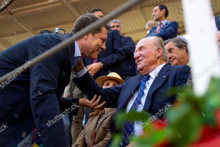 Spanish emeritus King Juan Carlos I (R) greets Castilla-La Mancha regional President Emiliano Garcia-Page (L) before a bullfight during the Milagros Fair in Toledo, Madrid, Spain, 09 March 2019.