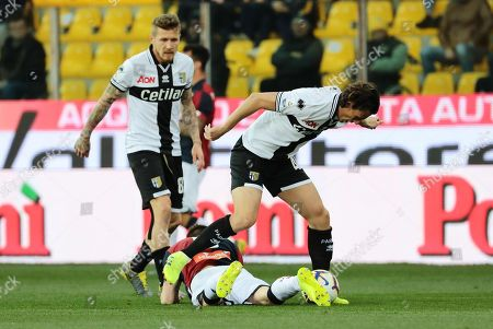 Parma's Roberto Inglese (R) with Juraj Kucka (L) and Genoa's Lukas Lerager  (down) in action during the Italian Serie A soccer match Parma Calcio1913 vs Genoa CFC at Ennio Tardini Stadium in Parma, Italy, 9 March 2019.