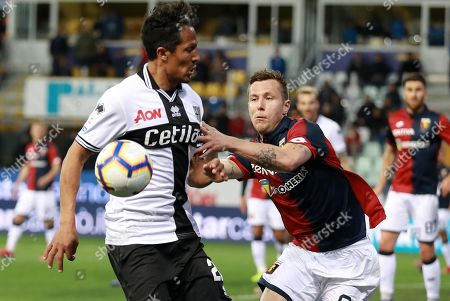 Parma's Bruno Alves  (L) and Genoa's Lukas Lerager  (R) in action during the Italian Serie A soccer match Parma Calcio1913 vs Genoa CFC at Ennio Tardini Stadium in Parma, Italy, 9 March 2019.