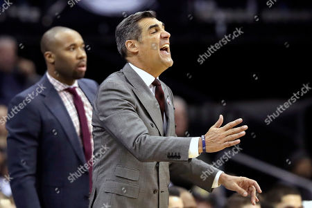 Villanova head coach Jay Wright, right, yells at his players during the second half of an NCAA college basketball game against the Seton Hall, in Newark, N.J. Seton Hall defeated Villanova 79-75