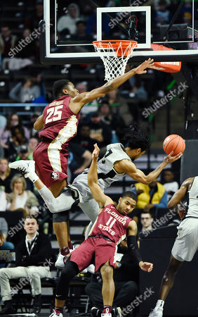 Wake Forest's Sharon Wright, Jr. (2) drives to the basket as Florida State's Mfiondu Kabengele (25) and (11) David Nichols defend during the second half of an NCAA college basketball game on in Winston-Salem, N.C. Florida State beat Wake Forest 65 to 57