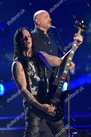 David Draiman, John Moyer. John Moyer and David Draiman of the band Disturbed perform at the Allstate Arena, in Rosemont, Ill