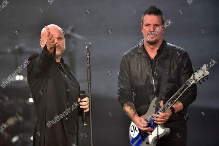 David Draiman, Dan Donegan. David Draiman and Dan Donegan of the band Disturbed perform at the Allstate Arena, in Rosemont, Ill
