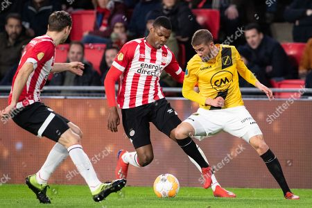 (L-R) Daniel Schwaab and Denzel Dumfries of PSV vie with Ramon Pascal Lundqvist of NAC Breda during the Dutch Eredivisie match between PSV Eindhoven and NAC Breda at the Phillips stadium in Eindhoven, The Netherlands, 09 March 2019.