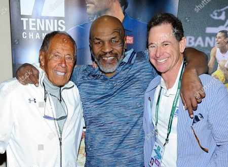 Stock Photo of Nick Bollettieri, Mike Tyson and Ken Solomon attend the Tennis Channel Suite at the BNP Paribas Open in Indian Wells, CA on Saturday, March 9.