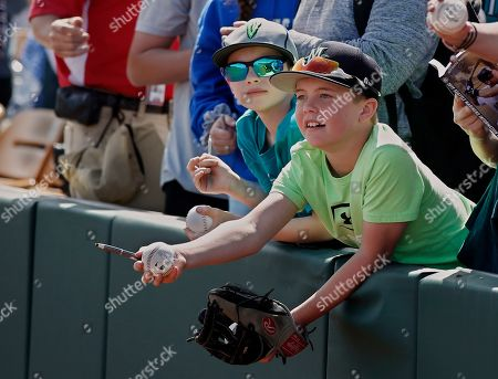 Chase Sharpe, Noah Bailey. Chase Sharpe, left, 9, and Noah Bailey, right, 10, both of Everett, Wa., wait for players to sign autographs before a spring training baseball game against the Los Angeles Dodgers, in Phoenix