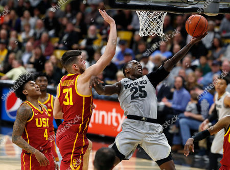 McKinley Wright IV, Nick Rakocevic, Kevin Porter Jr., Elijah Weaver. Colorado guard McKinley Wright IV, right, drives to the rim for a basket past USC guard Kevin Porter Jr., left, and forward Nick Rakocevic in the second half of an NCAA college basketball game, in Boulder, Colo. Colorado won 78-67