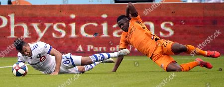 Montreal Impact's Saphir Taider (8) is tripped by Houston Dynamo's Oscar Garcia (27) during the first half of an MLS soccer match, in Houston