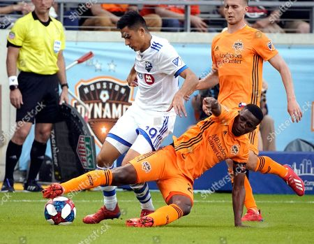 Houston Dynamo's Oscar Garcia, right, kicks the ball away from Montreal Impact's Mathieu Choiniere during the second half of an MLS soccer match, in Houston