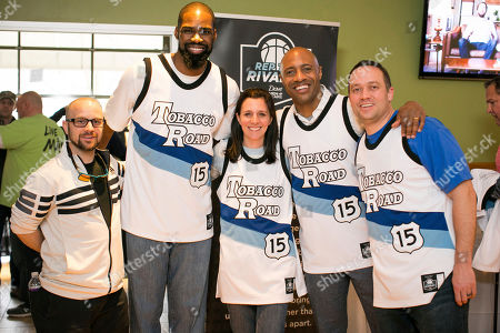 Former UNC Chapel Hill Forward Antawn Jamison (second from left) and Former Duke point guard Jay Williams (second from right) joined Dove Men+Care to give out limited-edition Tobacco Road #REPtheRIVALRY Jerseys and bring rivals together before the famous Duke, UNC rivalry game on in Chapel Hill, N.C