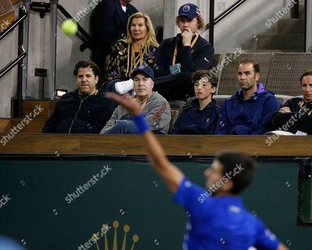 Pete Sampras watches Novak Djokovic (SRB) serve against Bjorn Fratangelo during the BNP Paribas Open at Indian Wells Tennis Garden in Indian Wells, California