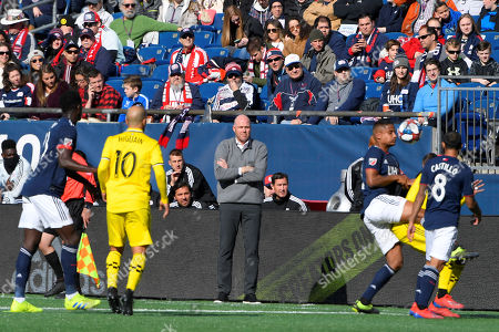Stock Photo of New England Revolution head coach Brad Friedel watches the action on the pitch during the MLS game between Columbus Crew and the New England Revolution held at Gillette Stadium in Foxborough Massachusetts. Columbus defeats New England 2-0 ..CAPTION CORRECTION.Corrects an earlier version with an incorrect headline