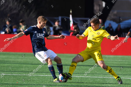 New England Revolution midfielder Scott Caldwell (6) (L) and Columbus Crew midfielder Will Trapp (6) (R) on the pitch during the MLS game between Columbus Crew and the New England Revolution held at Gillette Stadium in Foxborough Massachusetts. Columbus defeats New England 2-0