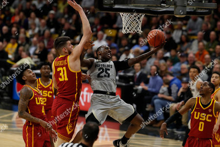 R m. Colorado Buffaloes guard McKinley Wright IV (25) drives past USC Trojans forward Nick Rakocevic (31) in the second half of an NCAA college basketball game, in Boulder, Colo. Colorado won 78-67