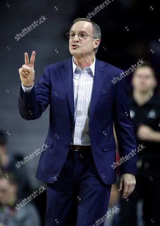 Oklahoma head coach Lon Kruger during the first half of an NCAA college basketball game against Kansas State in Manhattan, Kan