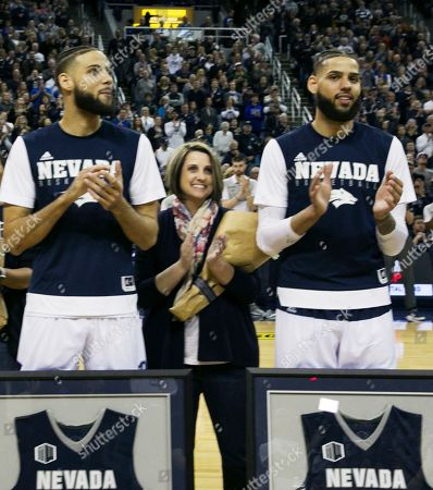 Nevada forwards' Caleb, left, and Cody Martin pose for a photograph with their mother Jenny Bennett before an NCAA college basketball game against San Diego State in Reno, Nev., . Nevada won, 81-53