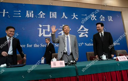 Yi Gang (C), Governor of the People's Bank of China (PBOC), Chen Yulu (R), Deputy governor of PBOC, Pan Gongsheng (L) Deputy governor of PBOC and Director of the state administration of foreign exchange arrive for a press conference on the sideline of the   second session of the 13th National People's Congress (NPC) in Beijing, China, 10 March 2019.