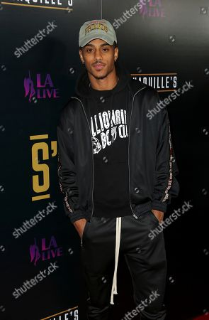Keith Powers arrives at the Grand Opening of Shaquille's at LA Live, in Los Angeles