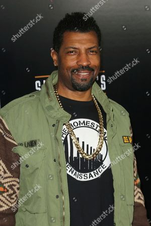 Deon Cole arrives at the Grand Opening of Shaquille's at LA Live, in Los Angeles