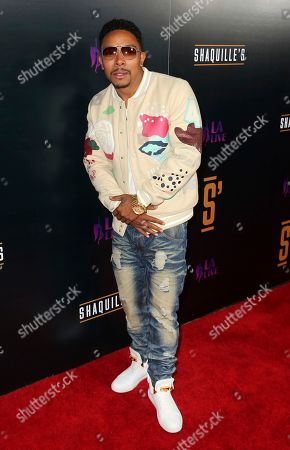 Allen Maldonado arrives at the Grand Opening of Shaquille's at LA Live, in Los Angeles