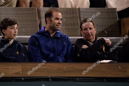 Former professional tennis player Pete Sampras, center, looks on as Novak Djokovic, of Serbia, faces Bjorn Fratangelo at the BNP Paribas Open tennis tournament, in Indian Wells, Calif