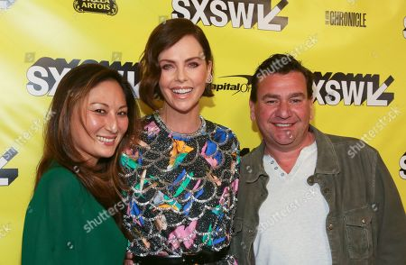 "Beth Kono, Charlize Theron, A.J. Dix. Charlize Theron, center, and producers Beth Kono, left, and A.J. Dix arrive for the world premiere of ""Long Shot"" at the Paramount Theatre during the South by Southwest Film Festival, in Austin, Texas"