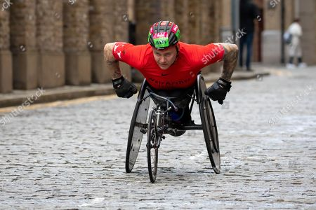 Britain's David Weir in action during the wheelchair race as he passes through Wapping on cobbled streets at the six mile point