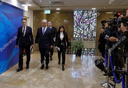 Israeli Prime Minister Benjamin Netanyahu (C) arrives escorted by his advisors (L-R) cabinet secretary Tzachi Braverman, Chief of Staff Yoav Horowitz, and spokeswoman Shir Cohen to the weekly cabinet meeting at his Jerusalem office, 10 March 2019.