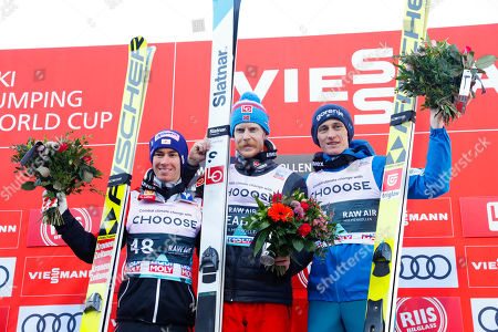 (L-R) Second placed Stefan Kraft of Austria, first placed Robert Johansson of Norway and third placed Peter Prevc of Slovenia on the podium for the Men's HS134 competition at the FIS Ski Jumping World Cup event in Oslo, Norway, 10 March 2019.