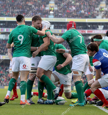 Stock Picture of Ireland vs France. Ireland's Rory Best celebrates scoring their first try with Conor Murray, Iain Henderson and Josh van der Flier