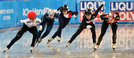 Stock Picture of South Korea's Min Jeong Choi, left, competes followed by China's Chunyu Qu, right, and Japan's Sumire Kikuchi, second right, during the Ladies 1000-meter quarterfinal at the ISU World Short Track Speed Skating Championships in Sofia, Bulgaria, on