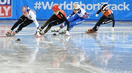 South Korea's Ji Yoo Kim, left, competes followed by China's Kexin Fan, second left, and Russia's Sofia Prosvirnova, second right, and Netherland's Rianne de Vries during the Ladies 1000-meter quarterfinal at the ISU World Short Track Speed Skating Championships in Sofia, Bulgaria, on