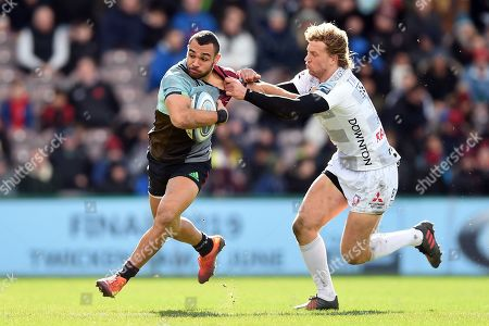 Joe Marchant of Harlequins fends Billy Twelvetrees of Gloucester Rugby