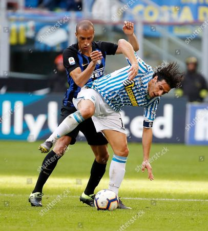 Inter Milan's Joao Miranda, left, challenges for the ball with Spal's Sergio Floccari during the Serie A soccer match between Inter Milan and Spal at the San Siro Stadium, in Milan, Italy