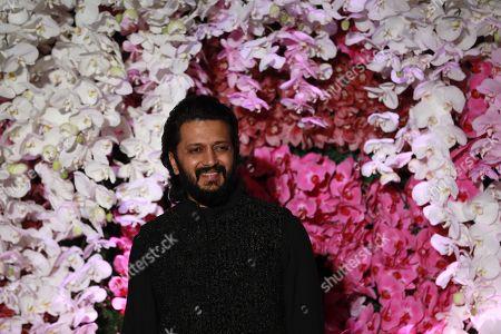 Bollywood actor Riteish Deshmukh poses as he arrives to attend the wedding reception of Akash Ambani, son of Reliance Industries Chairman Mukesh Ambani, in Mumbai, India, 10 March 2019. Akash Ambani got married to Shloka Mehta on 09 March 2019.