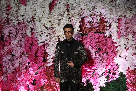 Bollywood director producer Karan Johar poses as he arrives to attend the wedding reception of Akash Ambani, son of Reliance Industries Chairman Mukesh Ambani, in Mumbai, India, 10 March 2019. Akash Ambani got married to Shloka Mehta on 09 March 2019.