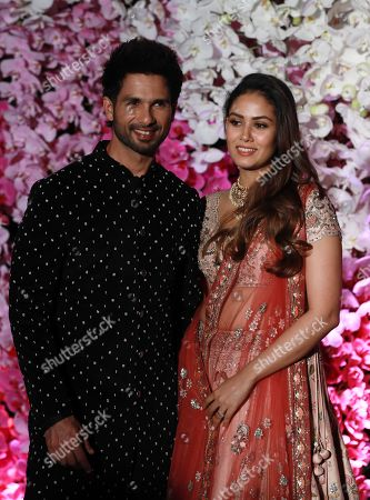 Bollywood actor Shahid Kapoor (L) and his wife Mira Rajput pose as they arrive to attend the wedding reception of Akash Ambani, son of Reliance Industries Chairman Mukesh Ambani, in Mumbai, India, 10 March 2019. Akash Ambani got married to Shloka Mehta on 09 March 2019.