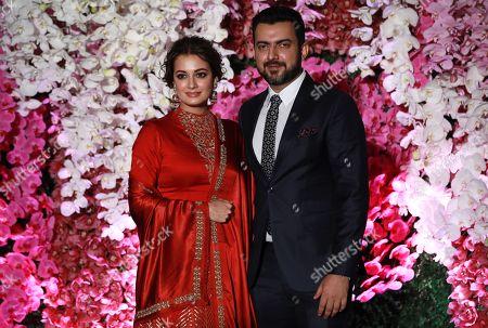 Bollywood actress Dia Mirza (L) and her husband Sahil Sangha pose as they arrive to attend the wedding reception of Akash Ambani, son of Reliance Industries Chairman Mukesh Ambani, in Mumbai, India, 10 March 2019. Akash Ambani got married to Shloka Mehta on 09 March 2019.