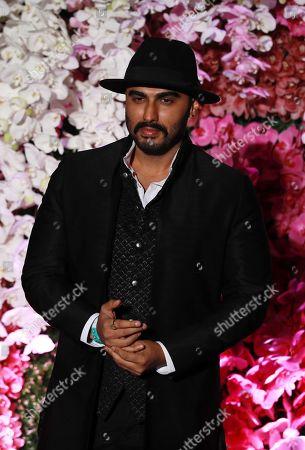 Bollywood actor Arjun Kapoor poses as he arrives to attend the wedding reception of Akash Ambani, son of Reliance Industries Chairman Mukesh Ambani, in Mumbai, India, 10 March 2019. Akash Ambani got married to Shloka Mehta on 09 March 2019.