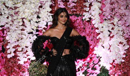 Stock Image of Bollywood actress Pooja Hegde poses as she arrives to attend the wedding reception of Akash Ambani, son of Reliance Industries Chairman Mukesh Ambani, in Mumbai, India, 10 March 2019. Akash Ambani got married to Shloka Mehta on 09 March 2019.