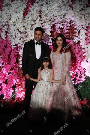 Bollywood actors Abhishek Bachchan (L) and his wife Aishwarya Rai Bachchan with their daughter Aaradhya pose as they arrive to attend the wedding reception of Akash Ambani, son of Reliance Industries Chairman Mukesh Ambani, in Mumbai, India, 10 March 2019. Akash Ambani got married to Shloka Mehta on 09 March 2019.